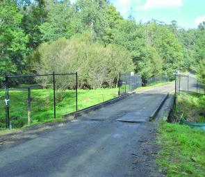 The cyclone fence erected at the Eltons Road Bridge over the Tarago River, Neerim.