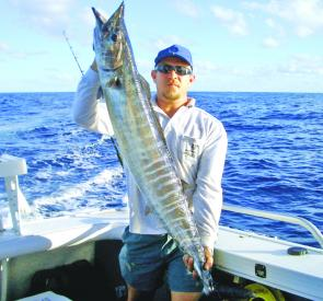 Andy Williams with his first wahoo caught on a high-speed hot pink skirted lure.