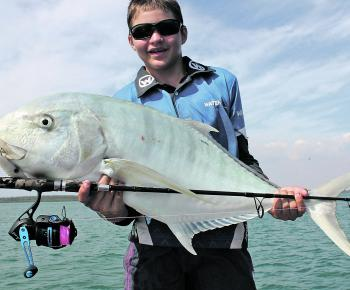 Jarred displays the fish of a lifetime, a 10kg+ golden trevally sight casted on the flats!