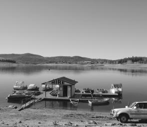 After Snowy Hydro began to lower Lake Jindabyne, the Snowline Holiday Park marina was moved to beside the boat ramp where the helicopter pontoon was.