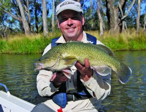 Marc Ainsworth with a neat Murray cod caught in the Goulburn River downstream of Shepparton.