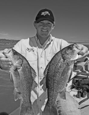Michael Pascoe with two of his winning bass.