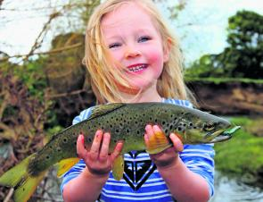 Lilah Kent was pretty happy when she got to help dad land this beaut little trout from the Barham River.