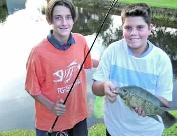 The Wardlaw lads enjoy catching tilapia: just look at those grins.