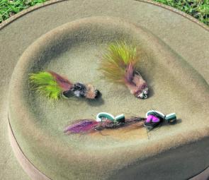 That's a pair of toads at the top of the hat's crown with two Gartside Gurglers a little lower. Tying instructions for both these flies are on the Internet.
