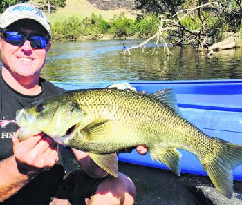 Curtis Parker of Mann River Caravan Park not only has your canoe and drop-off needs covered, but is also a gun bass fisho.
