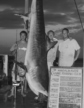 The Outcast crew with Andrew Finney's 338kg tiger shark caught on 15kg line.