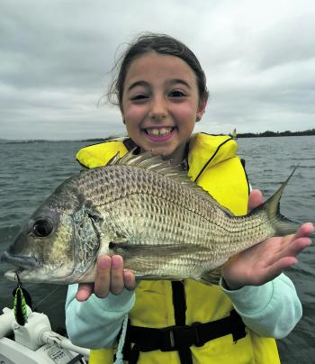 The author's daughter with her PB bream caught recently. A solid fish that left her smiling for quite some time.