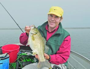 Love those early mornings: the author with a fat impoundment bass taken when the mist was still on the water.