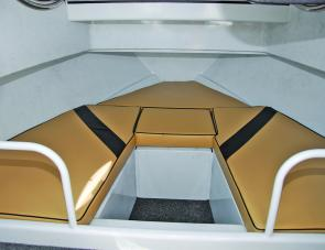 Well-padded bunks with storage below are solid features of this craft.