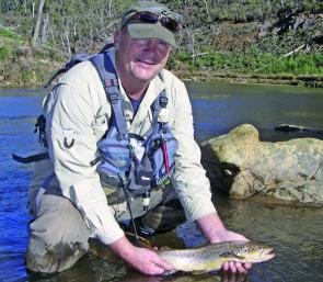 Mick Rosenboom with a 1kg brown trout taken in the lower Mitta Mitta River. Mick was fishing a bead headed nymph trailing behind a bushy dry fly.