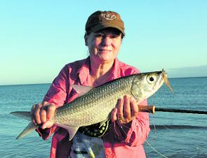 Denise Kampe displays an excellent tarpon taken from a beach on Dunk Island.