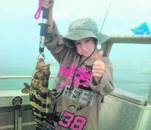 Young Hunter Gesch displays his first cod, caught off Mackay while fishing with his Dad.