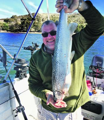 John Ramley with an Atlantic salmon caught between the boat ramp and Lion Island.