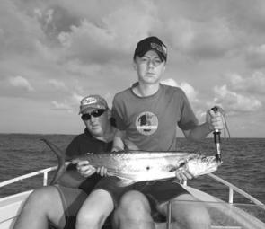 Daniel and Steve Magna with a good-sized mackerel from the Burnett River.