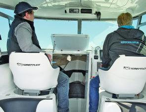 Plenty of the SL 26's main features are visible here, among them paired high backed seats that pamper skipper and mate.