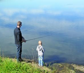 The stuff of memories: a father and son fishing for trout at Lake Wallace.