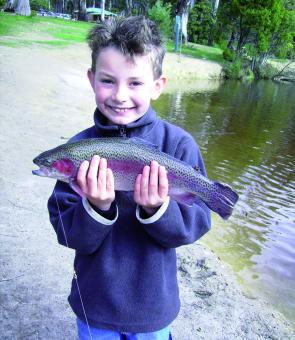 Nathan Ward with a rainbow trout he caught on PowerBait in Jubilee Lake at Daylesford. This is a great family fishing destination (photo: Linda Ward).