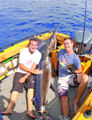 Jarred and Chrisso on board Magic with Jarred's first marlin.