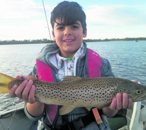 Mason with a Lake Fyans brown trout taken on a trolled Tassie Devil.