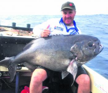Wayne Thorncraft with the huge blue eye trevalla he caught fishing the icy depths.