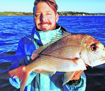 Craig Butcher with a winter snapper surprise.