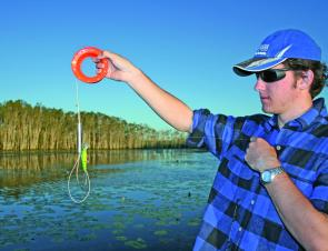 Most cord type retrievers use wire loops or chains to ensnare the lure's hooks, and are relatively easy to use single handed.