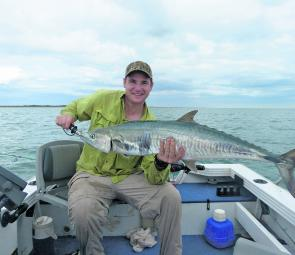 Little boat, big fish: the grin on Scott's face says it all.