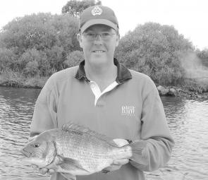 Jason Jeffrey with a 2kg bream from the Tambo River. It was a PB for Jason, and ate an Ecogear SX-40 lure. The bream fishing in the Gippsland Lakes has been sensational, and should get even better as the floodwaters clear (photo: Shane Jeffrey).