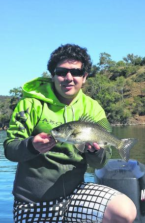 Local angler Lachie Ma with his first bass from a recent trip to Lake Glenbawn. More accustom to fishing the lake, Lachie was very impressed with the power of bass, even for an average-sized one.