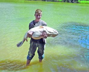 Jason Brady with a 124cm cod caught at Torrumbarry.