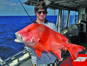 Howzat!? Aaron McGowan with a magnificent example of the type of big red regularly found offshore from Mackay.