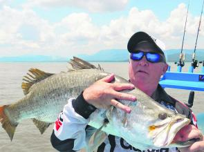 Boxing legend Barry Michael with one of two metre-plus fish caught while fishing.