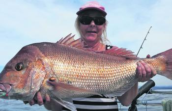 Annette Stewert with a cracker snapper caught in the depths off Batemans Bay.