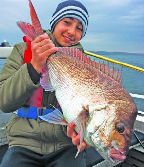 Young Joey Karadoukas with his first snapper on a plastic, a wonderful Jervis Bay 3kg red.