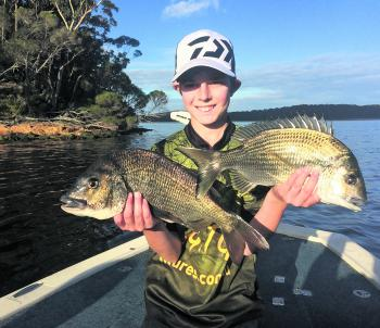 Gotta love kids getting into fishing. Here's young gun Ryan with a pair of cracking bream prior to release.