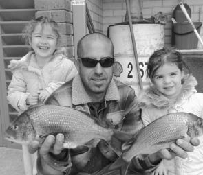 Dad Rick and his two girls, Zoe and Jae, got amongst some lovely bream recently using prawns for bait. The girl's two bream weighed 850g and 630g. Well done. (Photo courtesy of Trev and Lynette Hogan)