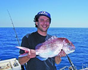 James Russouw with a perfect example of the school-size snapper that are in good numbers throughout the season. What a beautiful fish!