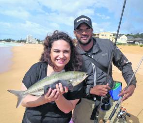Yudash and Reem Chetty with a surprise salmon among a bag of whiting and bream.