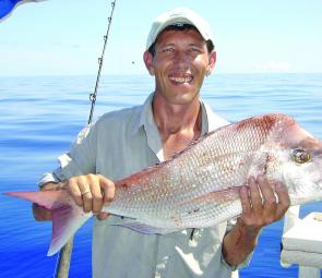 Graham Edmunds with a snapper caught out behind Keppel's.