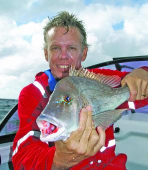 Local Wayne Roff looks pretty pleased with this grassy sweetlip caught out at Sunshine Reef recently in a mixed bag of reef fish and pelagics.