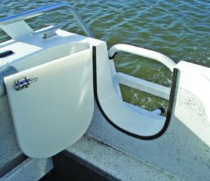 The transom door, fold-down ladder and wrap-over side rail make access over the stern a breeze.