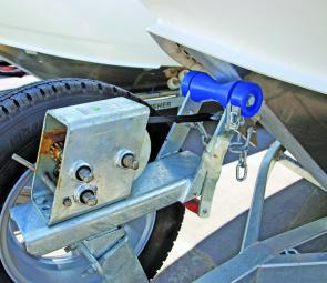 The seatbelt type winch straps have very high load ratings and are easy on the hands. Notice the safety chain attached securely.