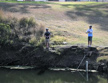The boys having a crack from the banks.