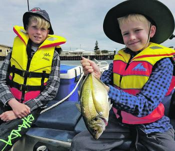 Hunter and Harvey showing dad how it's done at Queenscliff.