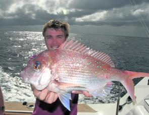 Ben Job with a tasty snapper. They should start to pick up once the temperature starts to drop.