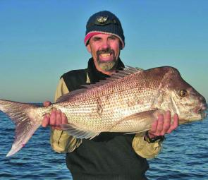 Gary Richardson shows off his 90cm snapper that continue to fish well throughout the Southern Bay.