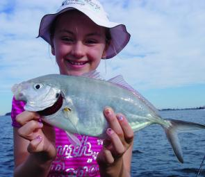 Rebecca with a good silver trevally caught at where else? Trevally Alley!