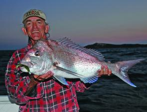 "Eric and a big Smiths Reef snapper taken just on dusk, using a Gambler 5"" 'green snot' and one of his now famous S10 rods."