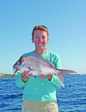 "Kim and a baking pan sized snapper caught at Smith's rock just north of the Cape using a watermelon coloured 5"" Gambler."